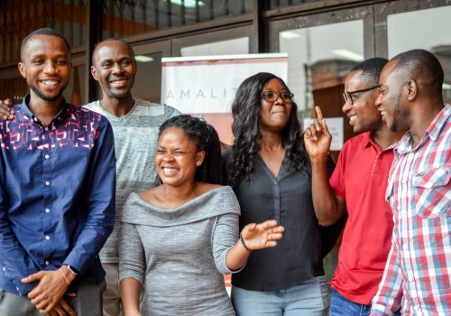 Six AmaliTech trainees standing together and smiling